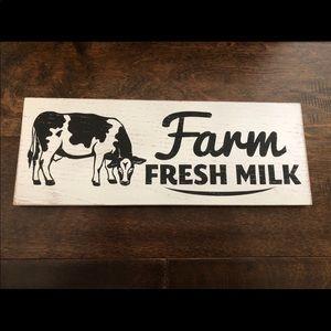 """Farm Fresh Milk"" decorative cow sign"